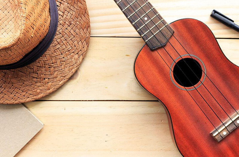 What's the distinction between a tenor and concert ukulele